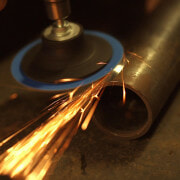 Power drill buffing round metal rod emitting sparks